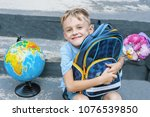 first grader is sitting with a... | Shutterstock . vector #1076539850