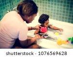 african descent kid enjoying...   Shutterstock . vector #1076569628