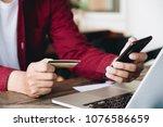 online payment man's hands... | Shutterstock . vector #1076586659