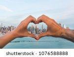 couple making a heart shape... | Shutterstock . vector #1076588888