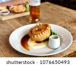 pie and mash with gravy  green... | Shutterstock . vector #1076650493