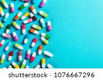 different color pills on blue... | Shutterstock . vector #1076667296