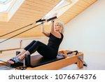 pilates reformer eldery blond... | Shutterstock . vector #1076674376