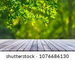 wood table with abstract... | Shutterstock . vector #1076686130
