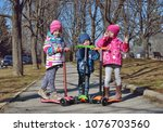 treee children on the scooters... | Shutterstock . vector #1076703560