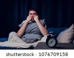 image of brunet with insomnia... | Shutterstock . vector #1076709158
