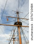 Small photo of Tall mast on old ship with rigging