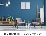 plant on white table between... | Shutterstock . vector #1076744789