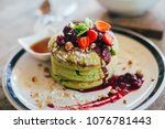 matcha pancakes with strawberry.... | Shutterstock . vector #1076781443