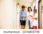 a doctor and a nurse discussing ... | Shutterstock . vector #1076803748