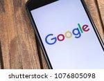 apple iphone and google logo....   Shutterstock . vector #1076805098