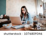 happy young woman studying on... | Shutterstock . vector #1076809346