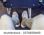 male passenger stretching her... | Shutterstock . vector #1076830640