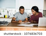 black couple working in the... | Shutterstock . vector #1076836703