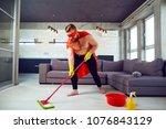 a fat  funny man in a superhero ...   Shutterstock . vector #1076843129