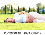 young beautiful pregnant woman... | Shutterstock . vector #1076845349