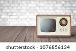 old tv tunner on a wooden table ... | Shutterstock . vector #1076856134
