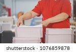 female hands sorts the stacks... | Shutterstock . vector #1076859878