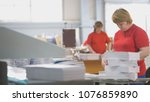 female workers sorting a paper... | Shutterstock . vector #1076859890