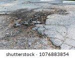 crack in asphalt street  broken ... | Shutterstock . vector #1076883854