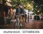 loving couple riding bicycle on ... | Shutterstock . vector #1076886206