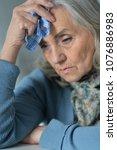 portrait of tired senior woman... | Shutterstock . vector #1076886983