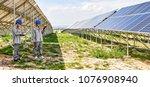 asian engineers patrol solar... | Shutterstock . vector #1076908940