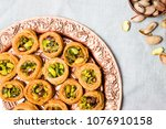 middle eastern dessert with... | Shutterstock . vector #1076910158