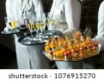canapes and wine buffet | Shutterstock . vector #1076915270