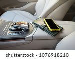 a telephone and purse lie on an ... | Shutterstock . vector #1076918210