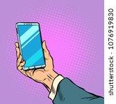 smartphone in male hand selfie. ... | Shutterstock .eps vector #1076919830