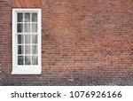 brick wall with only one window ... | Shutterstock . vector #1076926166