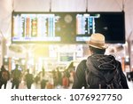 back view of a young traveler... | Shutterstock . vector #1076927750
