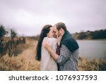 portrait of a loving couple... | Shutterstock . vector #1076937593