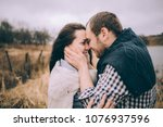 portrait of a loving couple... | Shutterstock . vector #1076937596