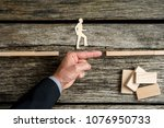 businessman supporting paper... | Shutterstock . vector #1076950733