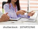 doctor consulting patient and... | Shutterstock . vector #1076951960