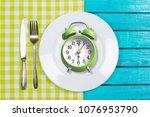 intermittent fastin concept | Shutterstock . vector #1076953790