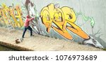 wide view of street artist... | Shutterstock . vector #1076973689