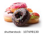 Group Of Glazed Donuts On Whit...