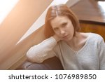 young dark haired woman sitting ... | Shutterstock . vector #1076989850
