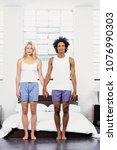 couple holding hands | Shutterstock . vector #1076990303