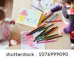 little girls drawing a colorful ... | Shutterstock . vector #1076999090