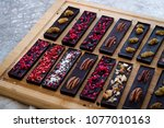 raw chocolate bars with nuts ... | Shutterstock . vector #1077010163