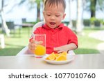 cute little asian 18 months   1 ... | Shutterstock . vector #1077010760