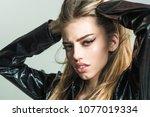 girl with long hair wears black ... | Shutterstock . vector #1077019334