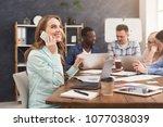business team talking about... | Shutterstock . vector #1077038039