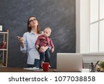 tired mother working at office...   Shutterstock . vector #1077038858