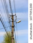 the post is electric with wires ... | Shutterstock . vector #1077051200