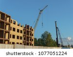 construction of a new apartment ... | Shutterstock . vector #1077051224